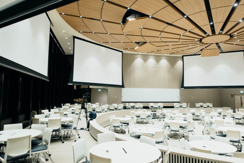 auditorium utilizing screens for cart services