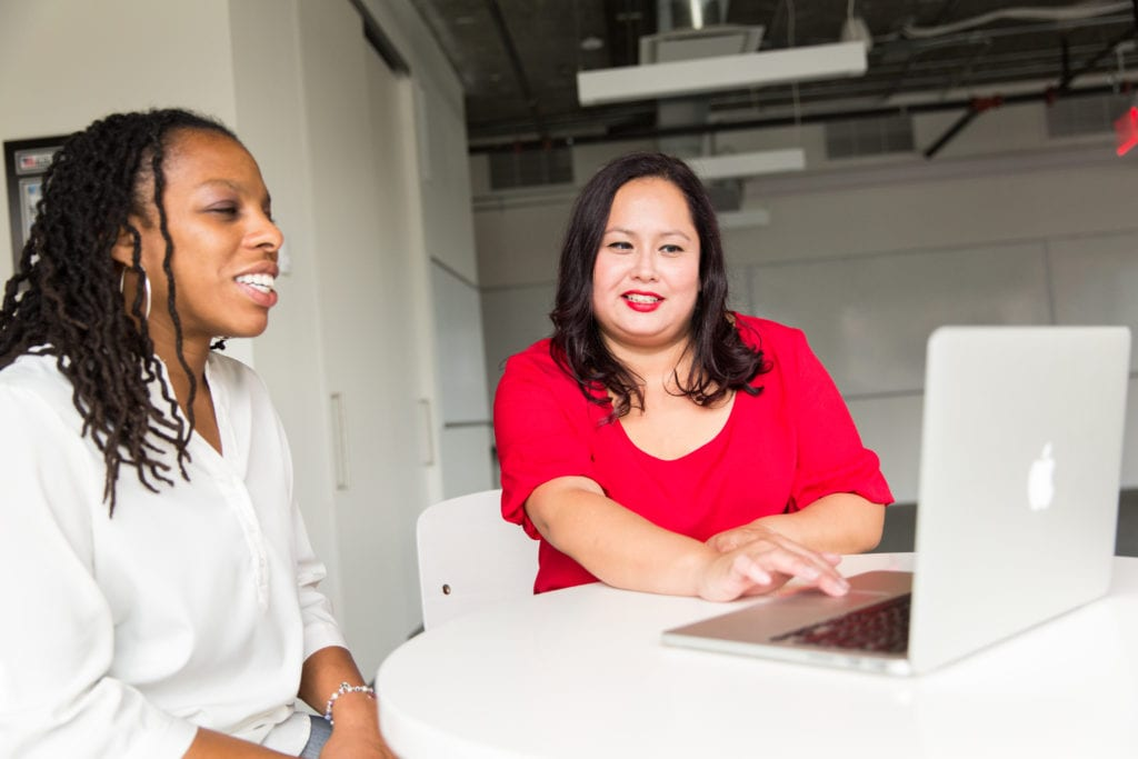 black woman and latina woman in a business mentor relationship