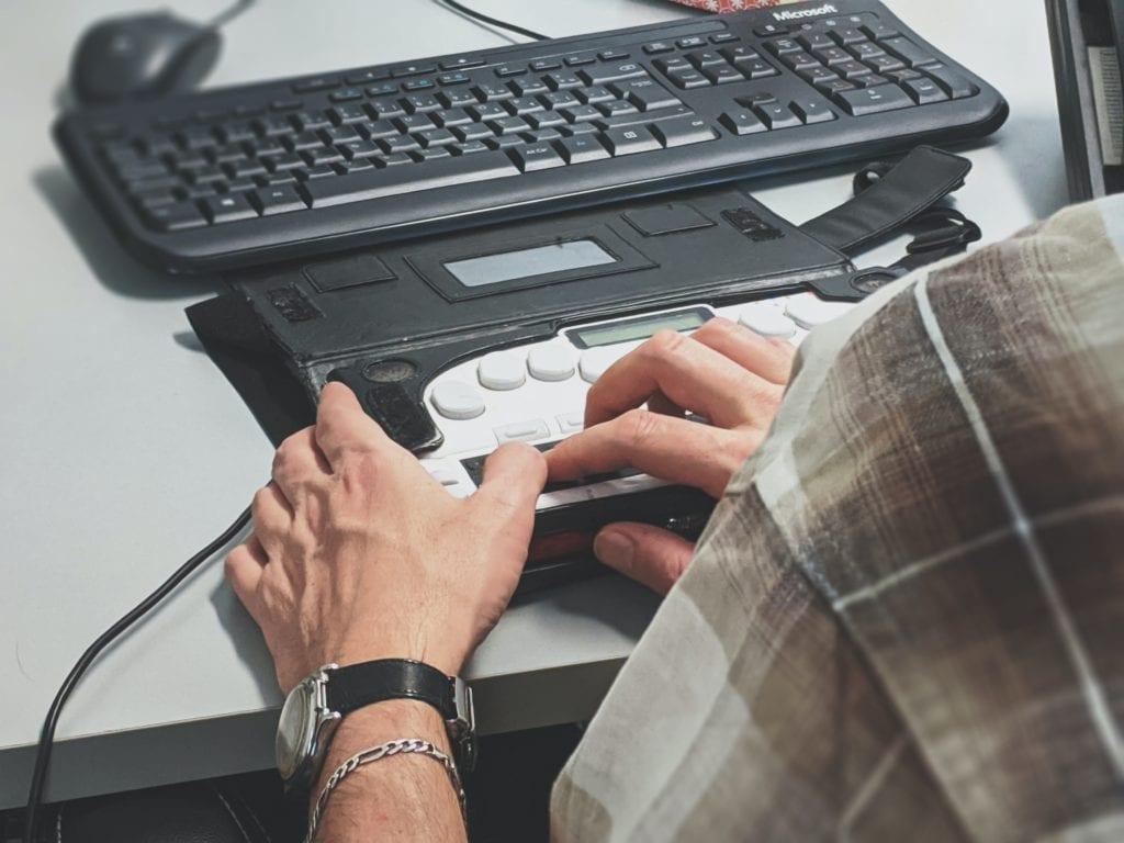 man using screen reader software