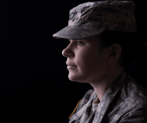 silhouette of a young woman in military uniform veteran-owned business