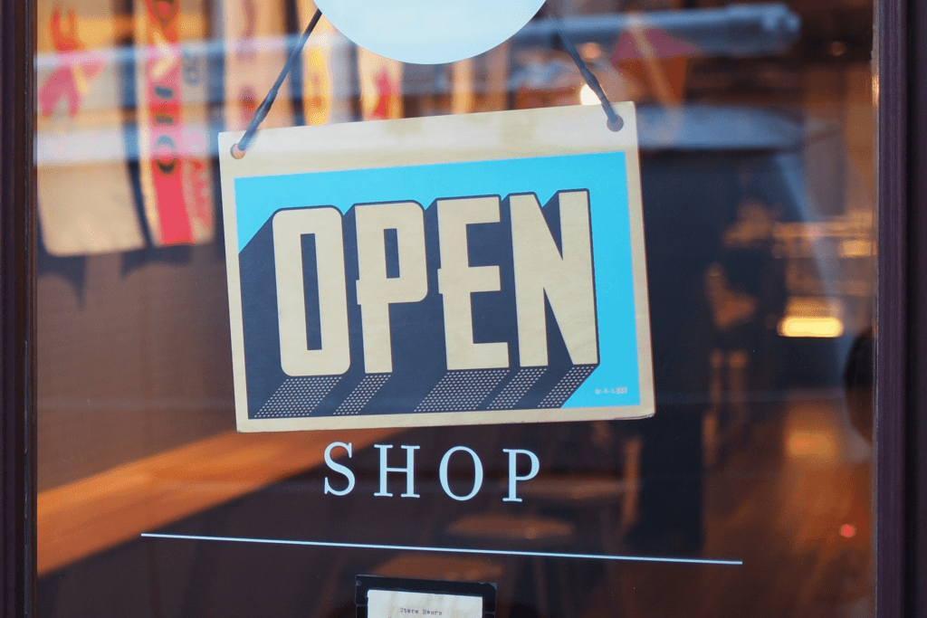 open sign in window of small business